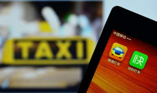 A smartphone shows the Didi Dacheb app which commands over 83 percent market share of China's domestic market for booking taxis