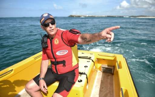 Australian lifesaver Garry Meredith on shark patrol in a custom-made rescue boat off the coast of Ballina, in April 2016