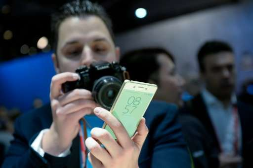 "A visitor takes photos of the new Sony smartphone ""Sony Xperia XA"" at the Mobile World Congress"
