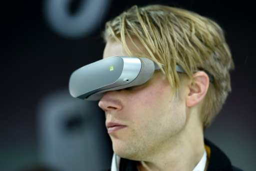 A visitor uses the LG 360 VR at the Mobile World Congress in Barcelona on February 21, 2016
