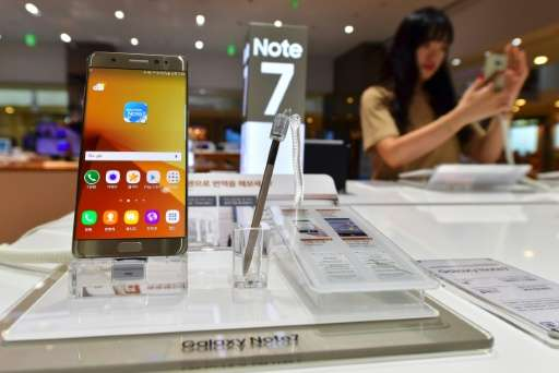 A woman tests a Samsung Galaxy Note7 smartphone at a Samsung showroom in Seoul on September 2, 2016