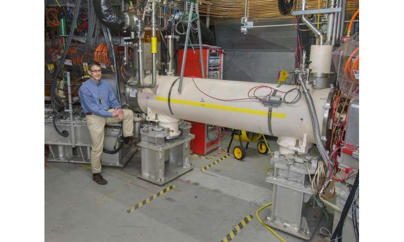 Beam-beam compensation scheme doubles proton-proton collision rates at RHIC