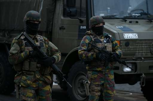 Belgian soldiers stand guard near Brussels airport in Zaventem on March 23, 2016 a day after terror attacks hit the city