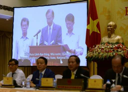 Chen Yuan Cheng, chairman of Formosa Ha Tinh Steel Corp, delivers an apology via a video message projected during a press confer