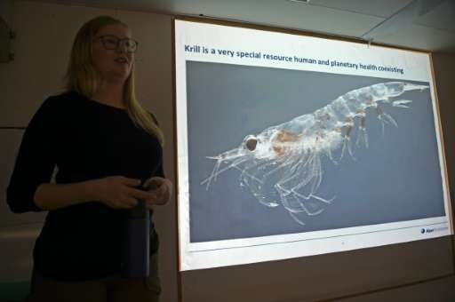 Cilia Indahl, head of sustainability at Norwegian fishing company Aker BioMarine, speaking next to a picture of a krill aboard t