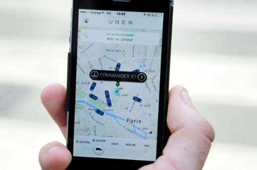 Co-founder Travis Kalanick says Uber, the app seen in Paris on June 17, 2015, was inspired by the Jitney and draws parallels bet