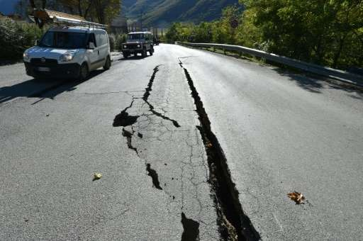 Cracks on the road outside the centre of Norcia, central Italy pictured a day after a 6.5-magnitude earthquake struck on October