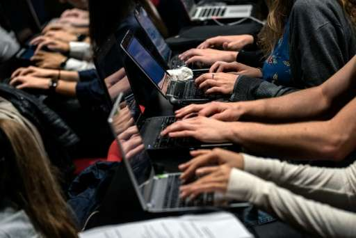 Due to a lack of certain symbols and accents, typing on some French keyboards, as these students at the Catholic University in L