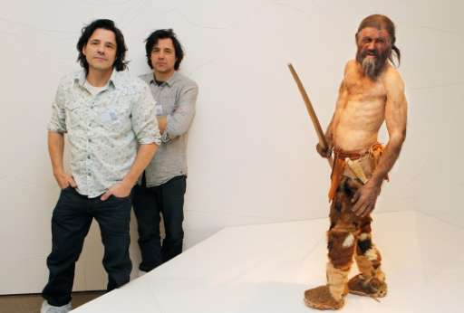 Dutch artist Adrie Kennis (L) and Alfons Kennis, the two artists who made the reconstruction of a mummy of an iceman named Otzi,