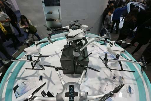 EHang commercial drones Series V.1 and Series V.2 (top C), which has a GPS unit attached are displayed at the CES 2016 Consumer