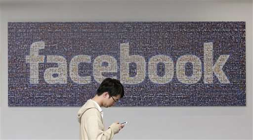Facebook posts strong 4Q as company closes gap with Google