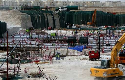 Foreign laborers work at the construction site of the al-Wakrah football stadium, one of Qatar's 2022 World Cup stadiums, on May