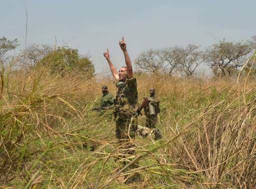 French Garamba National Park security advisor Peter Philippot coordinates a helicopter evacuation for a team of rangers to be re