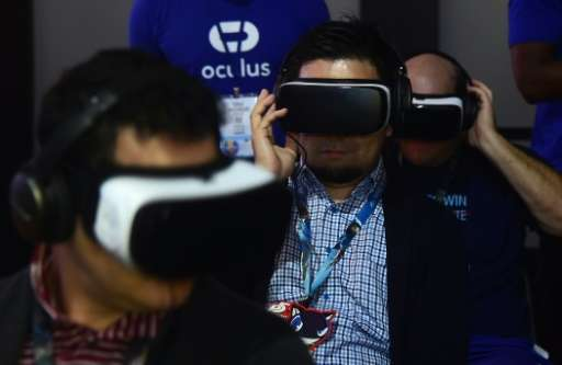Gaming fans sample Samsung's Gear VR powered by Oculus during the 2016 Electronic Entertainment Expo (E3) annual video game conf