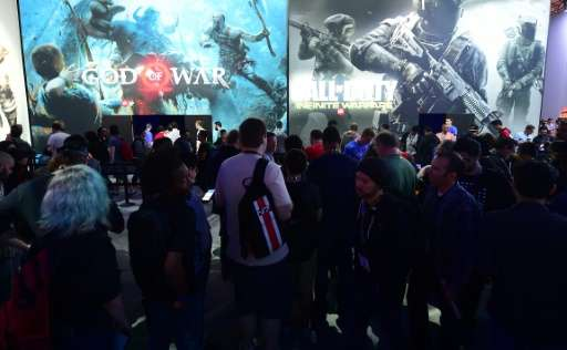 Gaming fans wait in line to sample 'Gods of War' and 'Call of Duty'  during the 2016 Electronic Entertainment Expo (E3) annual v