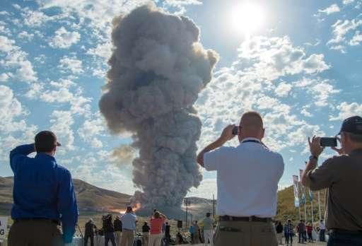 Guests watch the second and final test for the Space Launch System's booster, on June 28, 2016 in Promontory, Utah