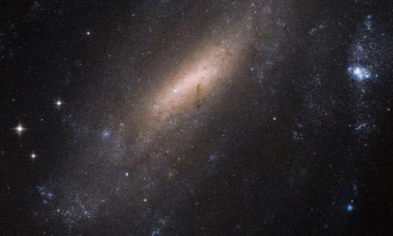 Hubble 'cranes' in for a closer look at a galaxy
