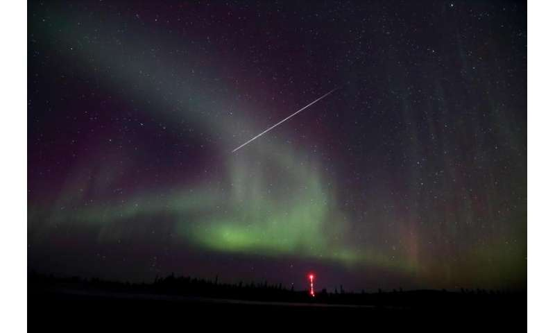 Image: Taurid meteor captured against Northern lights