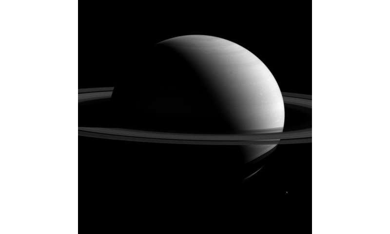 Image: Tethys dwarfed by Saturn
