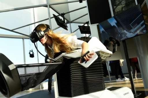In a glass cube inside a MK2 cinema near France's national library in Paris, viewers can choose between HTC Vive, Playstation VR