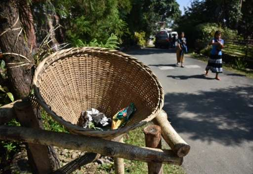 In Mawlynnong, bamboo dustbins stand at every corner, volunteers sweep the streets at regular intervals and large signs order vi