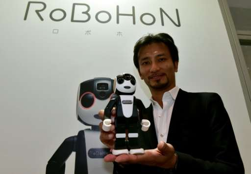Japanese firm Sharp presented a tiny prototype robot called RoBoHon, pictured on October 6, 2015, that doubles as a mobile telep