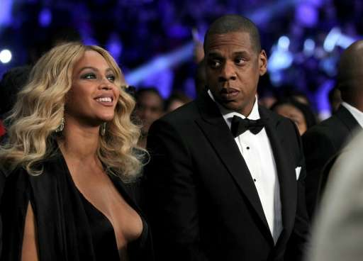 Jay-Z (R), pictured with his wife Beyonce on November 21, 2015, bought Tidal for $56 million from Swedish-listed company Aspiro