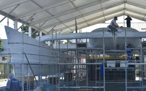 Labourers work on on the hull of an under-construction self energy producer, multihull 'Energy Observer', in Saint-Malo, western