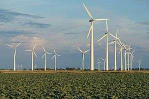 Large-scale wind energy slows down winds and reduces turbine efficiencies