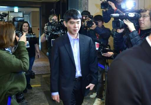 Lee Se-Dol (C), one of the greatest modern players of the ancient board game Go, arrives for the third game of the Google DeepMi