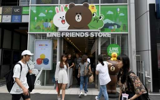 Line, owned by South Korea's Naver Corp, debuted in New York where its stock soared about 27% by the close