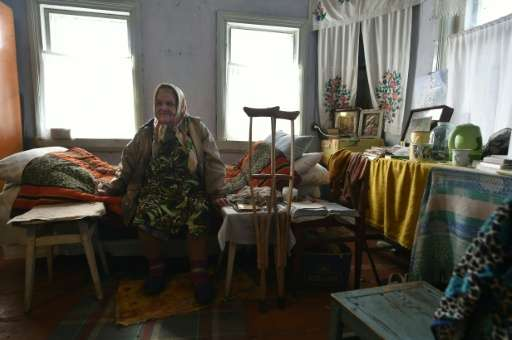 """Maria Urupa, who is in her early 80s, is a """"samosely"""", or self-returner, as inhabitants of the Chernobyl exclusion zon"""