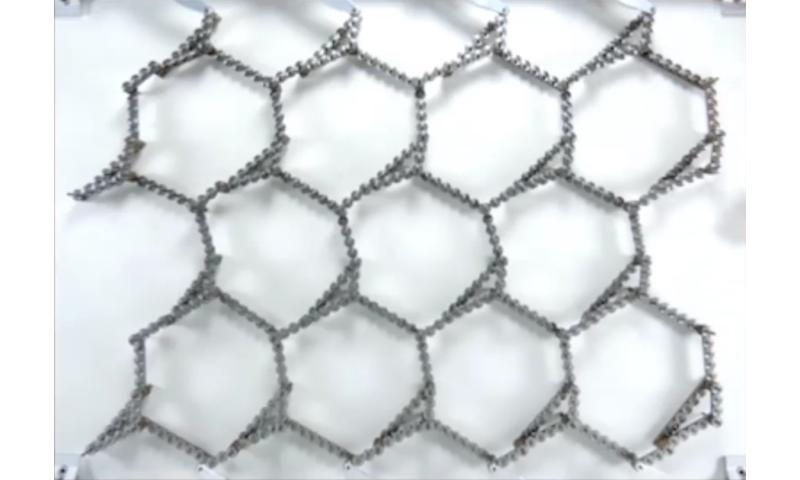 Metamaterial built from gears