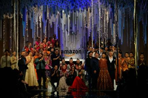Models present creations by Indian fashion designers during the Amazon India Fashion Week Autumn/Winter 2016 finale in New Delhi