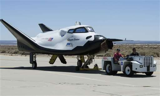 NASA adds third company as space station shipper; shuttle back (Update)