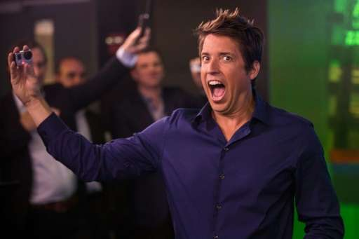 Nick Woodman, founder and CEO of GoPro celebrates during the company's initial public offering (IPO) at the Nasdaq Stock Exchang