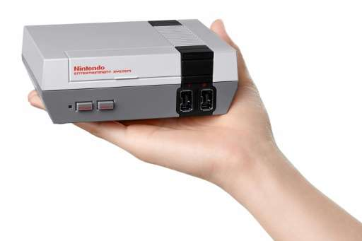 Nintendo launched a palm-sized version of its eighties era games console, setting up an old versus new showdown with rival Sony