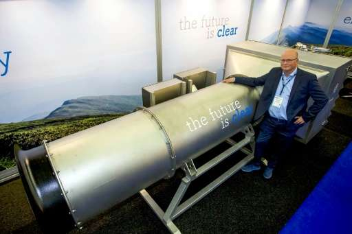 One of the group's Managing Partner Peter van Wees posing next to a system he created to filter fine and ultra-fine particles fr