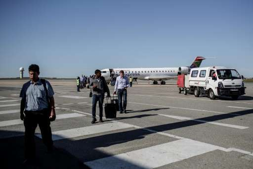 Passengers disembark from a South African Express flight at George airport