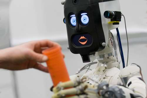 People favour expressive, communicative robots over efficient and effective ones