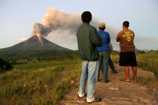 People look at the Momotombo volcano erupting in Papalonal community in La Paz Centro, Leon, Nicaragua on December 2, 2015