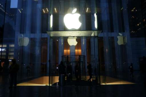 People make their way in and out of an Apple store on Fifth Avenue in New York on February 23, 2016