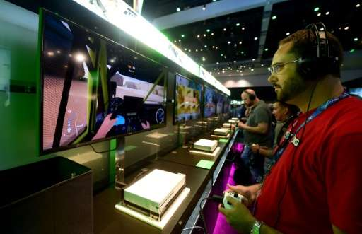 People play 'Forza Horizon 3' during the 2016 Electronic Entertainment Expo (E3) annual video game conference and show in Los An