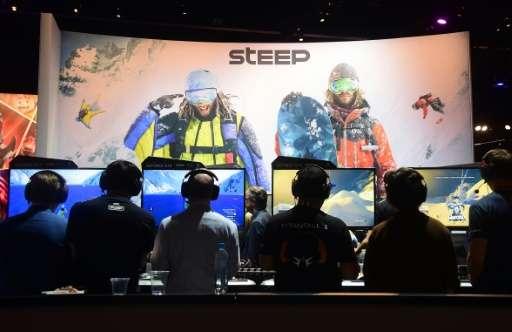 People play 'Steep' by Ubisoft during the Electronic Entertainment Expo (E3) annual video game conference and show on June 14, 2