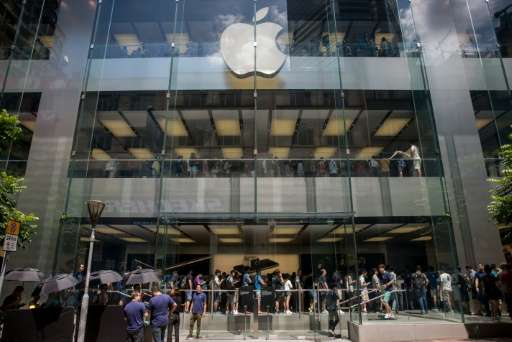 People queue for the new iPhone 7 during the opening day of sales at an Apple store in Hong Kong on September 16, 2016