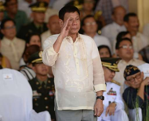 Philippines President Rodrigo Duterte salutes during a military parade and change of command ceremony, at the military headquart