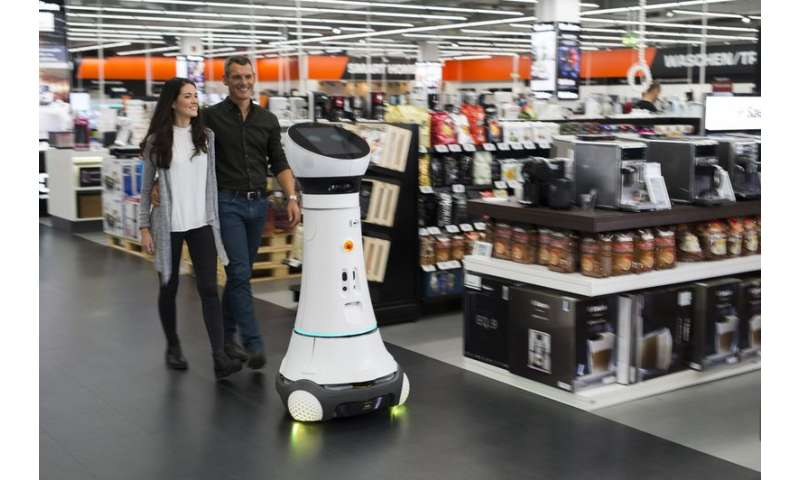 Robotic store greeter assists customers
