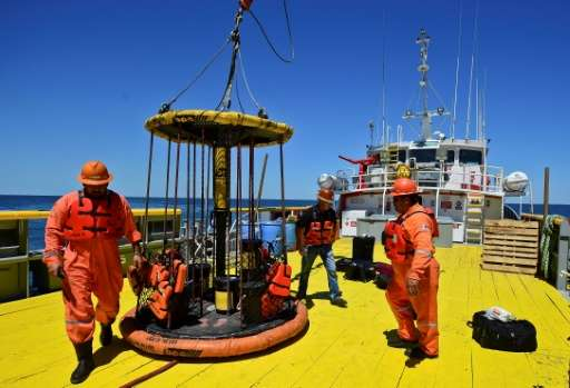 Sailors and workers load supplies for the the L/B MYRTLE Offshore Support Vessel -a scientific platform in the Gulf of Mexico