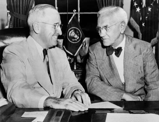 Scottish biologist Alexander Fleming, pictured (R) in 1949 with US president Harry Truman, was cleaning bowls in his lab when  n