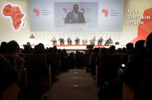 """Senegal President Macky Sall (L) delivers a speech in Dakar during the opening of the """"Next Einstein Forum"""" (NEF) on M"""